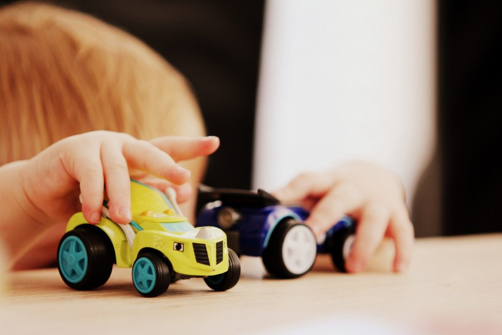 A child plays with toy cars